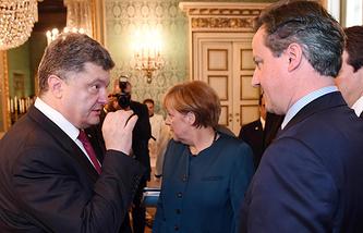 Президент Украины Петр Порошенко, канцлер Германии Ангела Меркель и премьер-министр Великобритании Дэвид Кэмерон