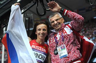 Олимпийская чемпионка Мария Савинова и тренер Владимир Казарин