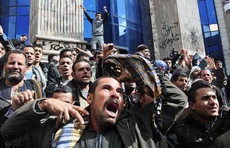 Протесты в Каире, осуждающие убийства коптов в Ливии