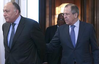Глава палестинского МИД Рияд аль-Малики и министр иностранных дел России Сергей Лавров