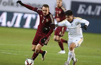 Эпизод из товарищеского матча между сборными России и Казахстана