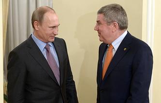 Владимир Путин и президент МОК Томас Бах