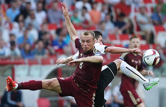 Эпизод из матча между сборными России и Австрии