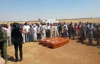 Похороны Айлана и Галипа Курди и их матери Рехан