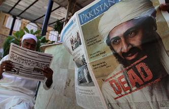 Первая полоса газеты с портретом Усамы бен Ладена
