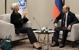 """Глава Международного валютного фонда (МВФ) Кристин Лагард и президент России Владимир Путин во время встречи на саммите """"Группы двадцати"""" (G20)"""