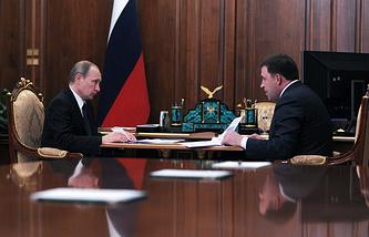 Президент РФ Владимир Путин и губернатор Свердловской области Евгений Куйвашев во время встречи в Кремле