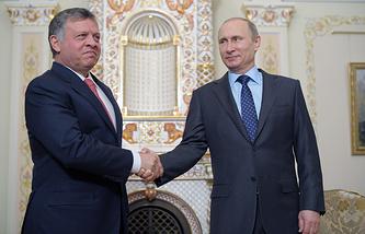 Король Иордании Абдалла II и президент РФ Владимир Путин во время встречи в резиденции Ново-Огарево, 2014 год
