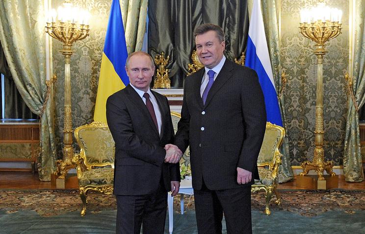 Russia's President Vladimir Putin and his Ukrainian counterpart Victor Yanukovich