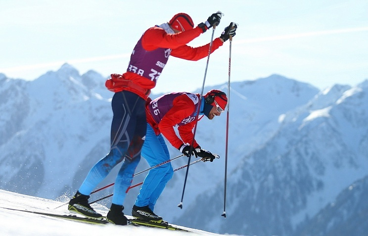 Russian skier Alexei Petukhov (right)