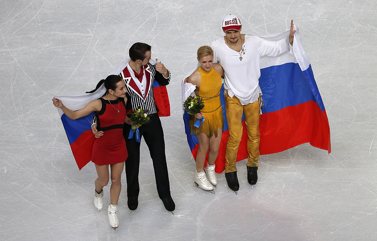 Gold medalists Tatiana Volosozhar (2-R) and Maxim Trankov (R) of Russia and Silver medalists Ksenia Stolbova (L) and Fedor Klimov (2-L) of Russia celebrate after the Pairs Free Skating