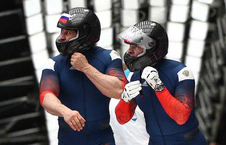 Alexander Zubkov and Alexei Voevoda after two-man bobsleigh event at Sochi Olympics