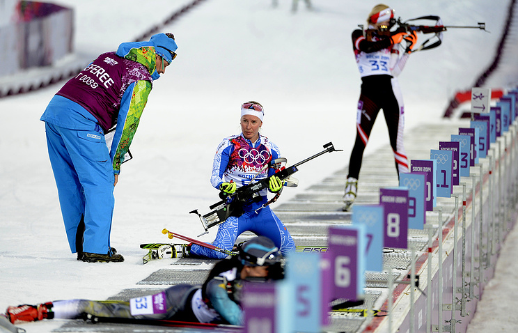 Referee talks to Kadri Lehta of Estonia during the Women's 15km Individual competition