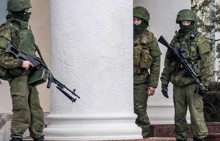Armed men in Ukraine's Crimea