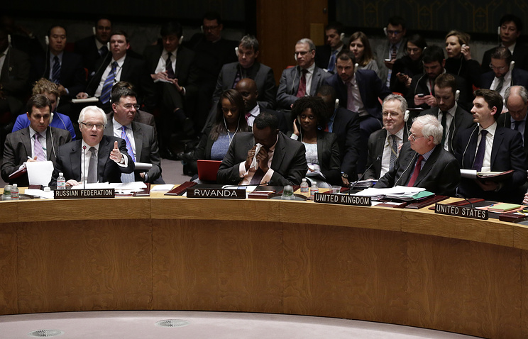 Russian Ambassador to the United Nations Vitaly Churkin (left) is seen addressing the United Nation Security Council meeting