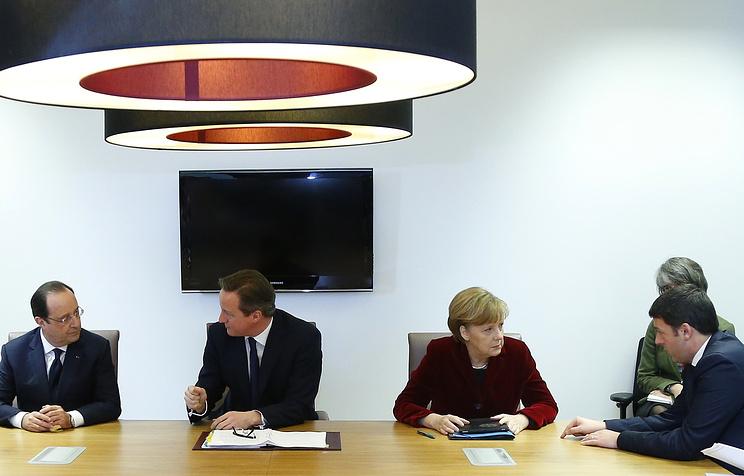 Francois Hollande, David Cameron, Angela Merkel and Matteo Renzi speak during a meeting on the sidelines of an EU summit in Brussels
