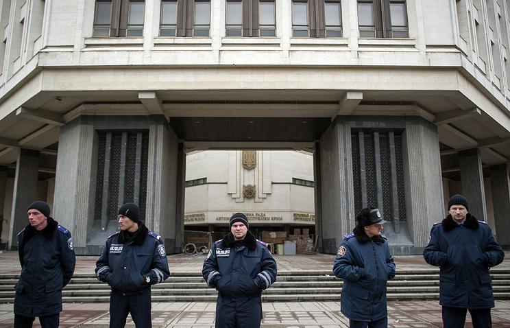Police guarding the parliament building in Crimea's Simferopol