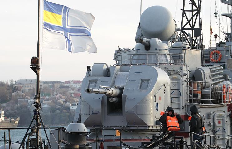 Ukrainian servicemen stand guard aboard the Ukrainian Navy ship 'Ternopil' in the harbor of Sevastopol