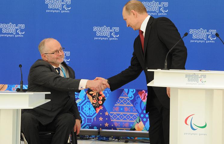 International Paralympic Commitee (IPC) president Philip Craven (L), and Russia's president Vladimir Putin