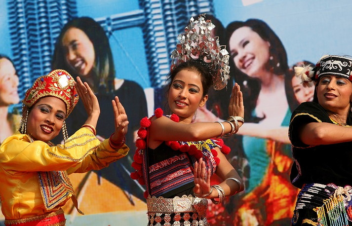 Dance troupe perform the cultural performance showing the Malaysian multi cultural diversity