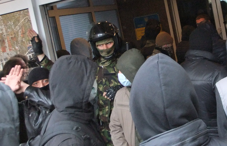A police officer seen in a crowd of protesters in Donetsk on April 12, 2014