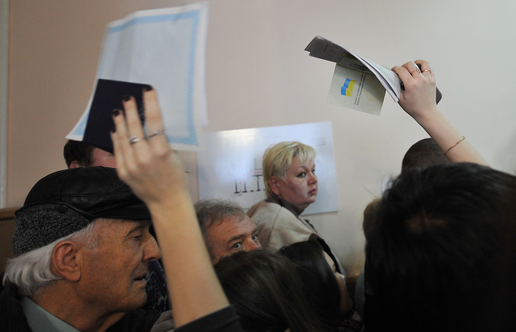People stand in line to apply for Russian citizenship in Crimea