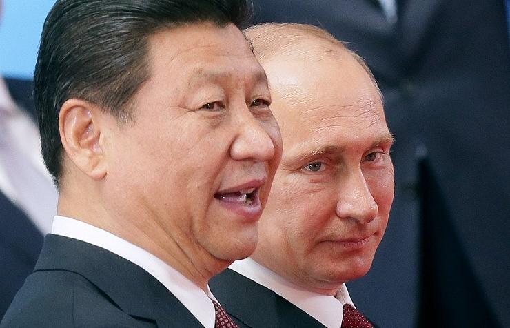 Xi Jinping (L) and Vladimir Putin (R)