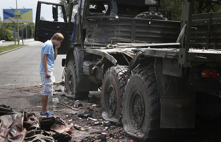 Wrecked truck of supporters of the self-proclaimed Donetsk People's Republic on road leading to the Donetsk International Airport