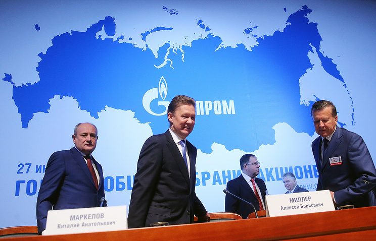 Gazprom CEO Alexei Miller (center)