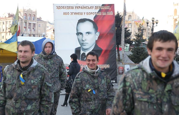 A portrait of Stepan Bandera (background) seen in Kiev