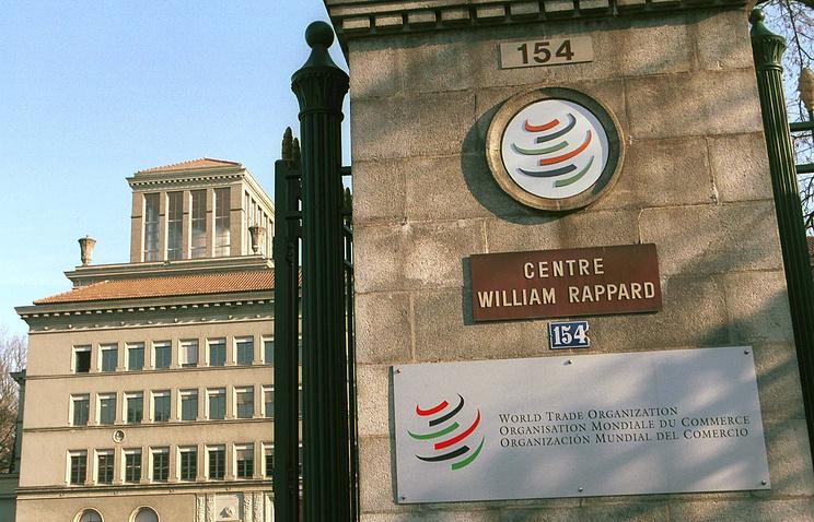 The entrance of the World Trade Organization's ( WTO ) headquarters in Geneva, Switzerland