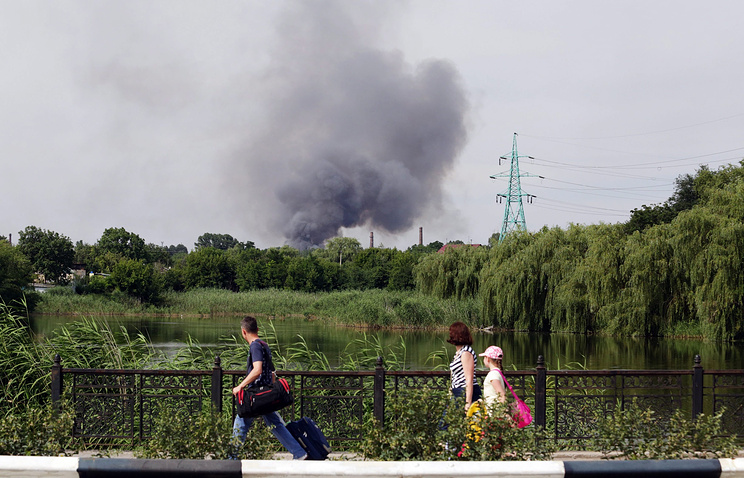Smoke rises in the city of Donetsk after it was shelled Jul. 21