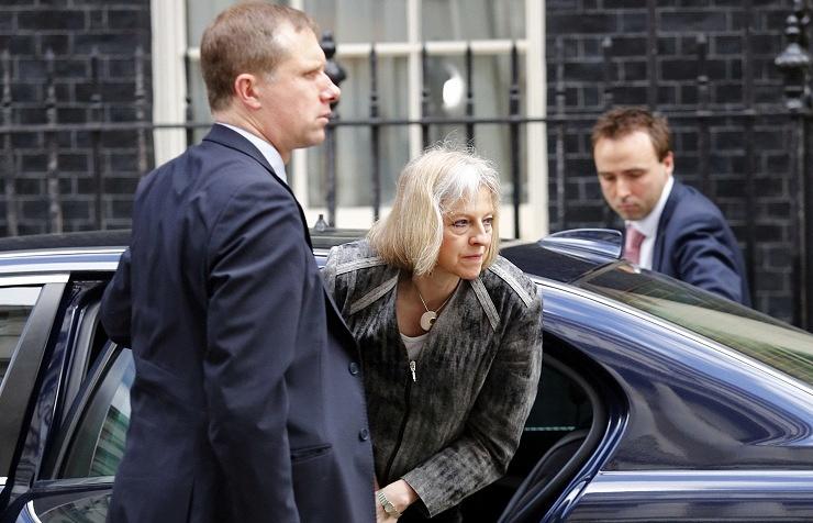 Home Secretary Theresa May (center)