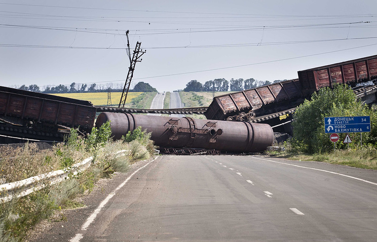A blown up railway bridge blocks the road between Kharkiv and Donetsk in Ukraine