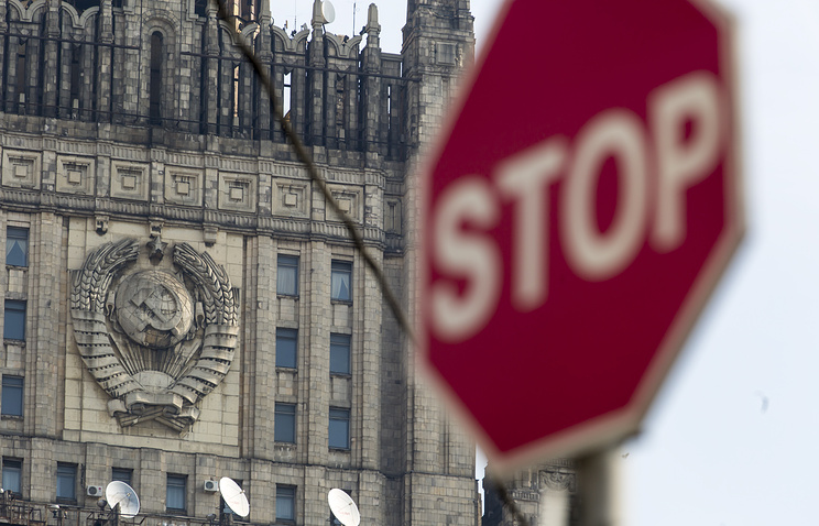 A stop sign seen in front of the Russian Foreign Ministry building in Moscow
