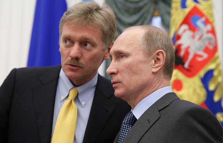 Russian President Vladimir Putin (R) and presidential spokesman Dmitry Peskov (L)