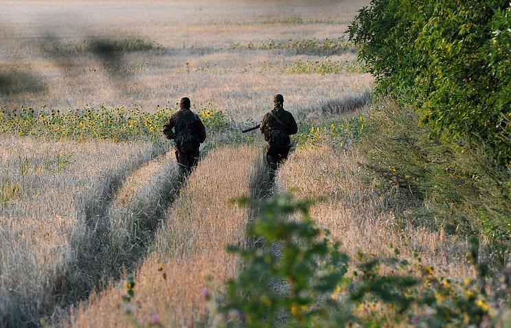 Russian servicemen patrol near the Ukrainian border