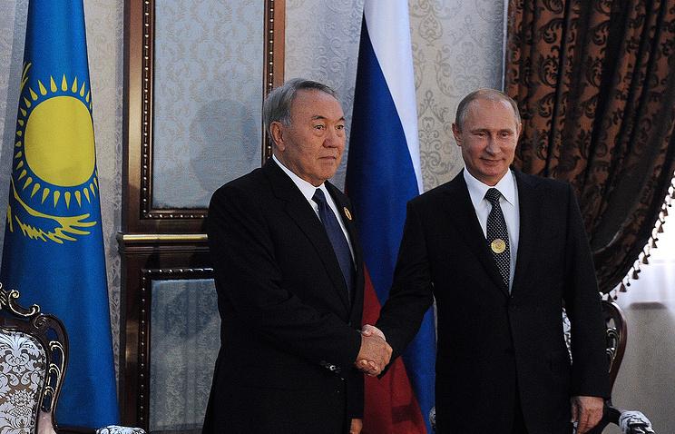 Kazakhstan's President Nursultan Nazarbayev and Russia's Vladimir Putin