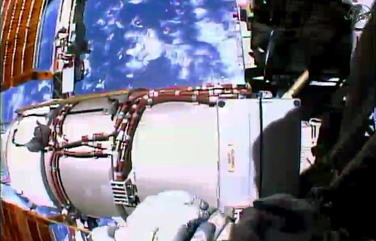 NASA astronauts repair a failed power regulator outside the International Space Station