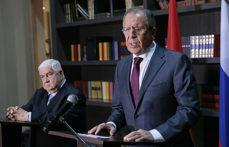 Sergey Lavrov (right) and Walid Muallem