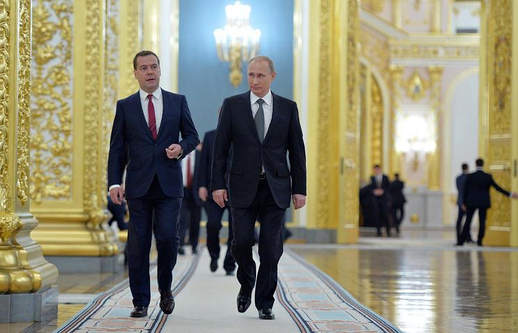 Russian Prime Minister Dmitry Medvedev and President Vladimir Putin
