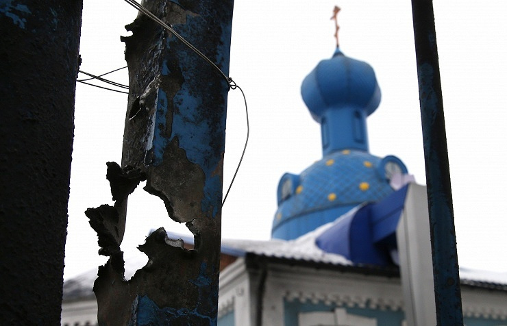 A fence damaged during a shelling attack in Donetsk