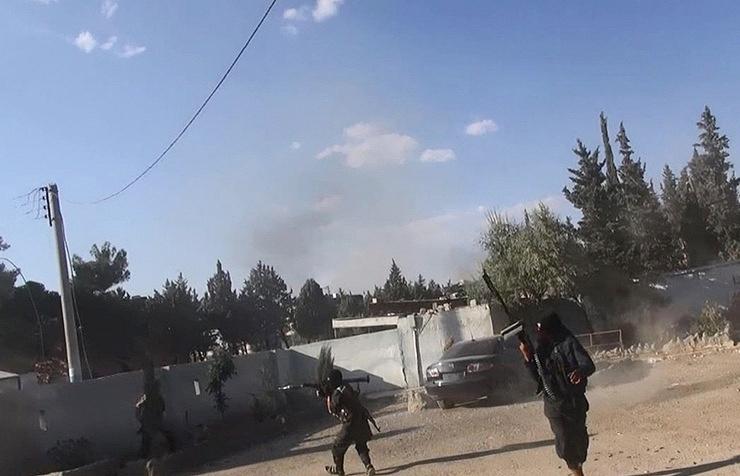 Islamic State militants seen in Syria's Kobani (archive)