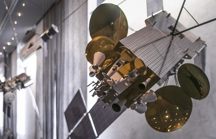 Model of a telecommunications satellite