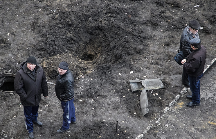 Crater after shelling in Donetsk, Ukraine (archive)