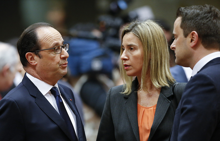 French President Francois Hollande (left) talks with EU Foreign Affairs and Security Policy chief Federica Mogherini and Luxembourg's Prime Minister Xavier Bettel