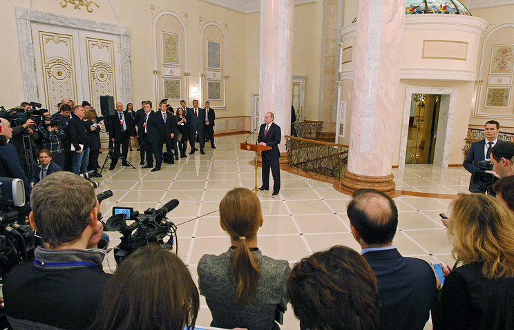 Russian President Vladimir Putin during a press conference following Ukraine peace talks