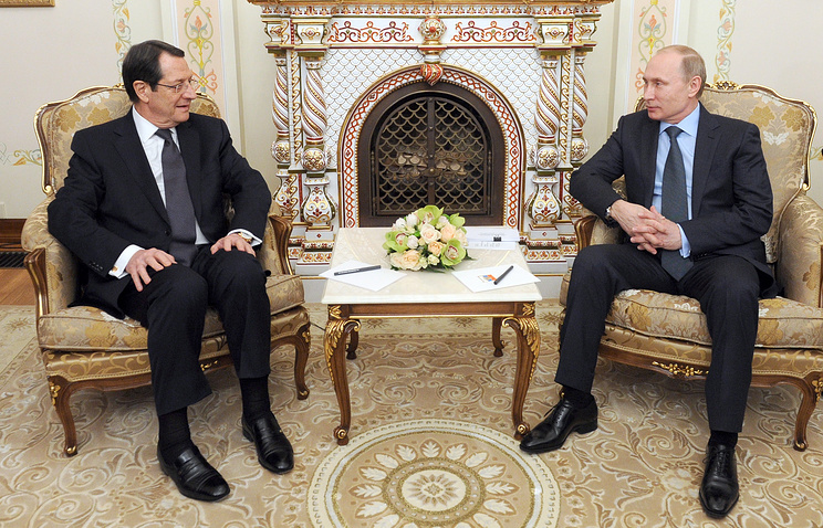 Vladimir Putin and his Cypriot counterpart Nicos Anastasiades