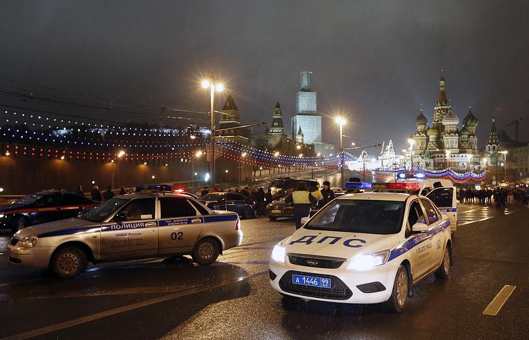 Police vehicles at the murder site of Boris Nemtsov