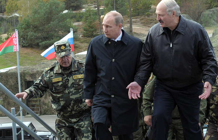 Russian President Vladimir Putin and Belarusian President Alexander Lukashenko during joint Russia-Belarus military drills in 2013
